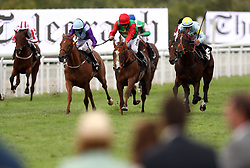 Runners and riders in the Telegraph Nursery Handicap during Ladies Day of the Qatar Goodwood Festival at Goodwood Racecourse.