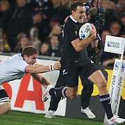 Israel Dagg, New Zealand, makes a break during the New Zealand V France, Pool A match during the IRB Rugby World Cup tournament. Eden Park, Auckland, New Zealand, 24th September 2011. Photo Tim Clayton...
