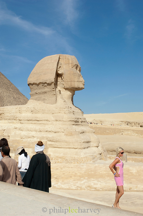 Tourists visit the Great Sphinx of Giza and the Pyramid of Khufu, Giza, Egypt