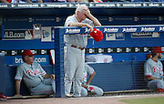 ATLANTA - JUNE 30:  Manager Charlie Manuel #46 of the Philadelphia Phillies wipes his forehead during the game against the Atlanta Braves at Turner Field on June 30, 2009 in Atlanta, Georgia.  The Braves beat the Phillies 5-4 in 10 innings  (Photo by Mike Zarrilli/Getty Images)