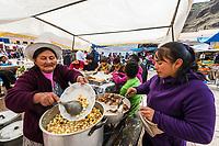 Pisac, Peru - July 14, 2013: Women cooking at Pisac market in the peruvian Andes at Pisac Peru on july 14th 2013