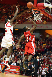 03 February 2007: Daniel Ruffin shoots, Osiris Eldridge attempts to block it off the glass.  In what is locally referred to as the War on Seventy Four, the Bradley Braves defeated the Illinois State University Redbirds 70-62 on Doug Collins Court inside Redbird Arena in Normal Illinois.