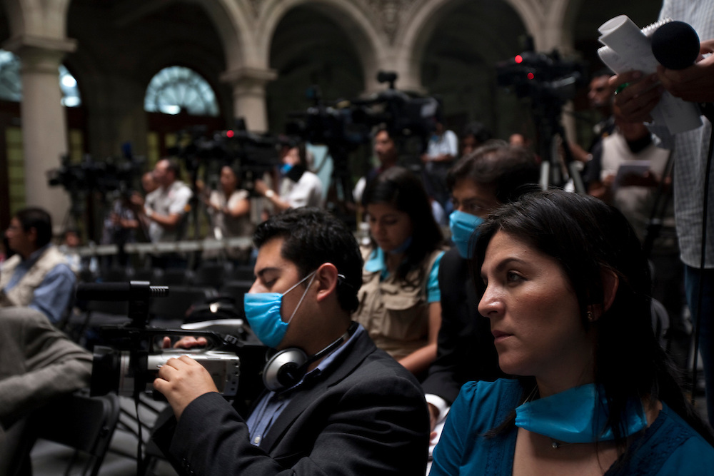 24 April 2009, Mexico City, Mexico--- Mexican Journalists listen to the Secratary of health outline the governments plan to combat a new strain of Swine Flu that has killed over 60 people, and made 1008 people sick. he World Health Organization is meeting to determine whether to raise its pandemic flu alert level  . --- Image by © Trevor Snapp