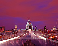 This one of the most rewarding delayed exposure images I have been lucky enough to capture. This photograph was taken on the centre of the Millennium Bridge over the river Thames leading up to St Pauls Cathedral at night. <br /> <br /> The most remarkable part of this photo is that there has been just enough light to leave a ghostly shadow of some of the passers by, none are possible to make out as only the outline of their bodies have been left but it gives us this amazing ghost effect representing the thousands of people who pass over this bridge to the spiritual and economic centre of the city. <br /> <br /> We have an amazing sky of red, orange, blue and purple over the City of London. The lights of the bridge really highlighting and drawing us into the historic centre of the city St Pauls.