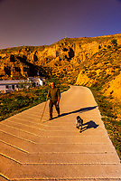 Man walking his dog, Gorafe, Granada Province, Andalusia, Spain.