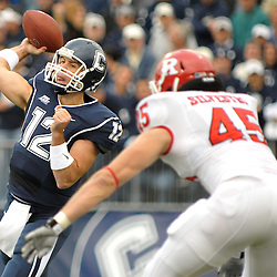 Oct 31, 2009; East Hartford, CT, USA; Connecticut quarterback Cody Endres (12) throws a pass during first half Big East NCAA football action between Rutgers and Connecticut at Rentschler Field.