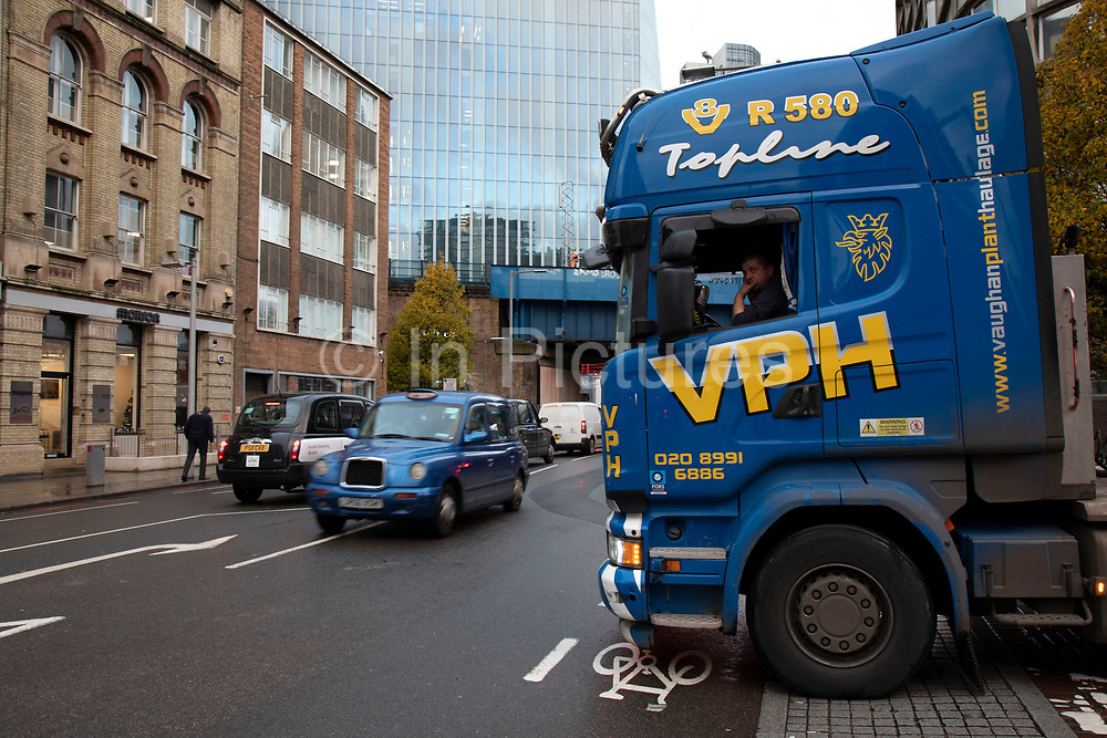Cab of a large heavy goods vehicle turning right onto Southwark Street on 27th November 2019 in London, England, United Kingdom. A great deal of construction in the capital means that the roads are often full of heavy good vehicles, which is a road safety concern for many other road users.