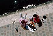 FRANCE, PARIS, CITY CENTER The Ile St. Louis, sunbathers on the quay along the River Seine
