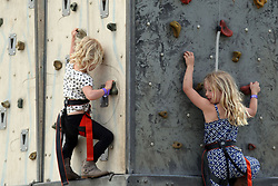 Peter and Autumn Phillips daughters Savannah (right) and Isla (left) on a climbing wall during the Royal Windsor Horse Show, which is held in the grounds of Windsor Castle in Berkshire.