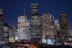 Downtown Houston, Texas skyline at night with buildings lit up.