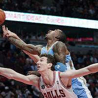 08 November 2010: Denver Nuggets' shooting guard #5 J.R. Smith is fouled as he goes to the basket over Chicago Bulls' center #3 Omer Asik during the Chicago Bulls 94-92 victory over the Denver Nuggets at the United Center, in Chicago, Illinois, USA.