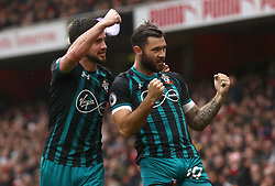 Southampton's Charlie Austin (right) celebrates scoring his side's second goal of the game during the Premier League match at the Emirates Stadium, London.