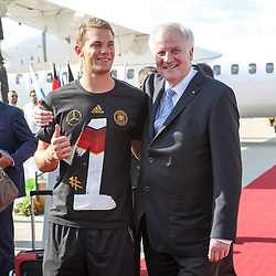 15.07.2014, Flughafen, Muenchen, GER, FIFA WM, Empfang der Weltmeister in Deutschland, Finale, im Bild l-r: Manuel Neuer #1 (Deutschland) und Horst Seehofer (Ministerpraesident) // during Celebration of Team Germany for Champion of the FIFA Worldcup Brazil 2014 at the Flughafen in Muenchen, Germany on 2014/07/15. EXPA Pictures © 2014, PhotoCredit: EXPA/ Eibner-Pressefoto/ Kolbert  *****ATTENTION - OUT of GER*****