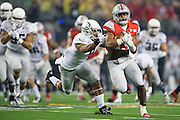 Ezekiel Elliott #15 of the Ohio State Buckeyes breaks free for a 33-yard-touchdown run against the Oregon Ducks in the 1st quarter of the College Football Playoff National Championship Game at AT&T Stadium on January 12, 2015 in Arlington, Texas.  (Cooper Neill for The New York Times)