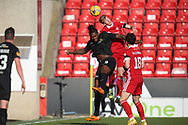 Aberdeen's Ross McCrorie (40) and Jay Emmanuel-Thomas (9) of Livingston battles for possession, tussles, tackles, challenges, during the Scottish FA Cup match between Aberdeen and Livingston at Pittodrie Stadium, Aberdeen, Scotland on 17 April 2021.