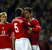 RUUD VAN NISTELROOY CELEBRATES SCORING 2ND GOAL WITH RIO FERDINAND<br />MANCHESTER UNITED 2005/06<br />MANCHESTER UNITED V SL BENFICA 27/09/05<br />THE UEFA CHAMPIONS LEAGUE GROUP D<br />PHOTO ROBIN PARKER FOTOSPORTS INTERNATIONAL