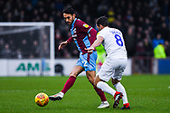 Levi Sutton of Scunthorpe United (22) passes the ball during the EFL Sky Bet League 1 match between Scunthorpe United and Coventry City at Glanford Park, Scunthorpe, England on 5 January 2019.