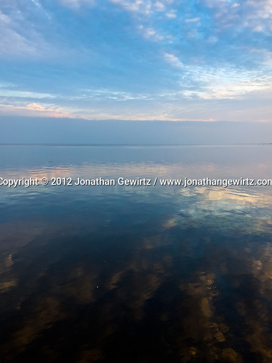Sky meets water just before sundown on Biscayne Bay in Miami, Florida. WATERMARKS WILL NOT APPEAR ON PRINTS OR LICENSED IMAGES.