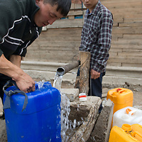 The driver for a Smithsonian archaeology team gets water at a well near saline Lake Erkhel.  These are widely scattered and the only source of water for local livestock.