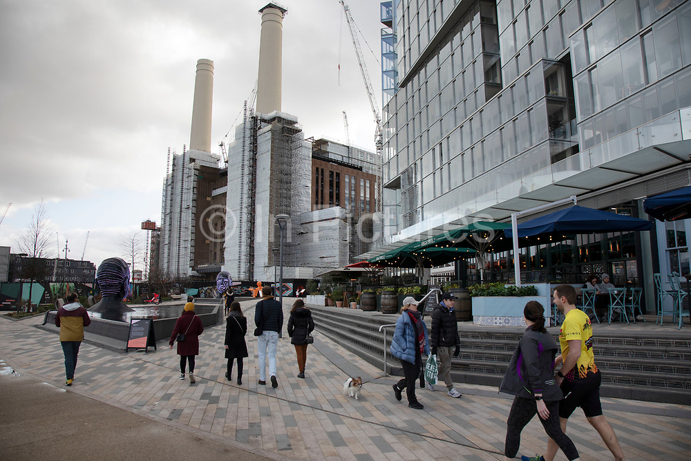Newly pedestrianised area near the redevelopment of Battersea Power Station and its surroundings on 1st February 2020 in London, England, United Kingdom. Battersea Power Station is a decommissioned coal-fired power station located on the south bank of the River Thames, in Nine Elms, Battersea, an inner-city district of South West London. Now a well advanced construction site and under development, the site will become both residential and commercial property.