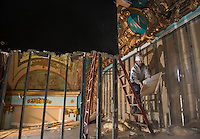 """Renovation work done by Bonnette, Page and Stone at the Colonial Theater in downtown Laconia.  Bob Ferguson works carefully to uncover the centerpiece of the upper stage revealing the year """"1914"""".  ©2016 Karen Bobotas Photographer"""