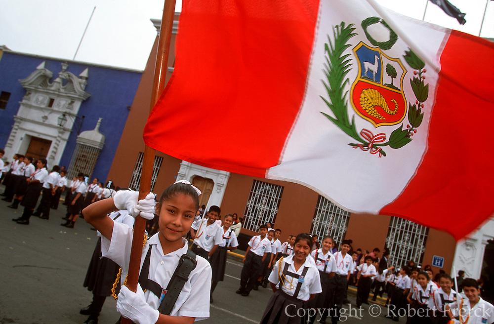 PERU, TRUJILLO, FESTIVALS Tribute to Flag; girl holding flag