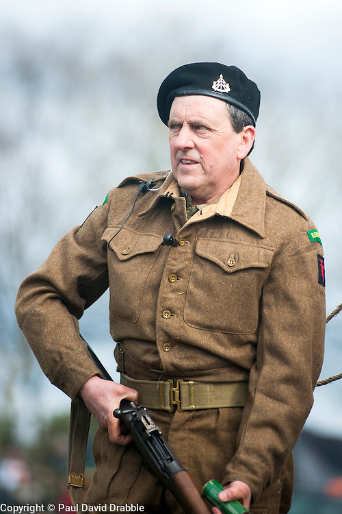 Reeactor portraying a British soldier from the 50th Divisions 61st Reconnaissance Regiment carrying a Lee-Enfield Rifle.Image © Paul David Drabble