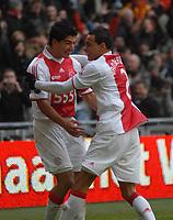 Amsterdam The Netherlands 24th January 2009: Eredivisie Ajax Amsterdam vs AZ Alkmaar. Luis Suarez (l) celebrates with goal scorer Gregory van der Wiel. The home side win 1-0. 24/01/2010 Credit Colorsport / Richard Wareham