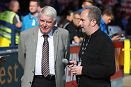 John Motson OBE about to be interviewed during the EFL Sky Bet League 1 match between AFC Wimbledon and Oxford United at the Cherry Red Records Stadium, Kingston, England on 29 September 2018.