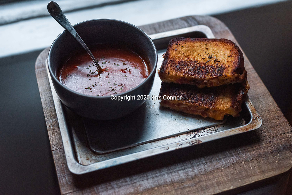 A Bacon Tomato Grilled Cheese with Firey Tomato Soup photographed in New York City