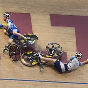 Alex Bird (left) Australia, and Mitchell Bullen, Australia, crash during the Keirin Semi Final at the 2012 Oceania WHK Track Cycling Championships, Invercargill, New Zealand. 23rd November  2011. Photo Tim Clayton...