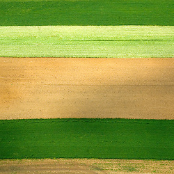 Aerial view of Amish Farm, showing the texture and lines in the earth. Aerial views of artistic patterns in the earth.