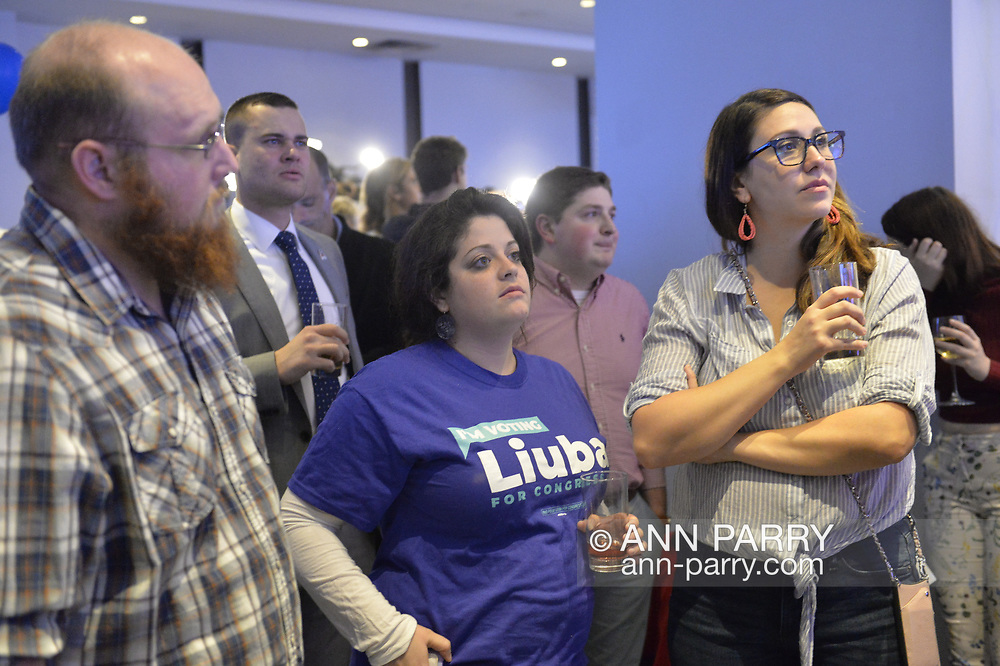 Garden City, New York, USA. November 6, 2018. Nassau County Democrats watch Election Day results at Garden City Hotel, Long Island. KAYLA COOPER, of Amityville, is wearing a T-shirt supporting Liuba Grechen Shirley, candidate for New York Congressional District 2.