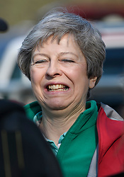 © Licensed to London News Pictures. 19/04/2019. Maidenhead, UK. Prime Minister THERESA MAY  meets with locals before helping out as a marshal at the Maidenhead Easter 10 run in her constituency of Maidenhead in Berkshire. Parliament currently on Easter recess after an extension to Article 50 was granted by the EU. Photo credit: Ben Cawthra/LNP