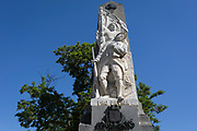 """The WW1 war memorial with the Latin Pro Patria inscription on the main Le Promenade street, on 24th May, 2017, in Lagrasse, Languedoc-Rousillon, south of France. Pro Patria is a line from the Roman lyrical poet Horace's Odes, translated as: """"It is sweet and proper to die for the fatherland."""" Lagrasse is listed as one of France's most beautiful villages and lies on the famous Route 20 wine route in the Basses-Corbieres region dating to the 13th century."""