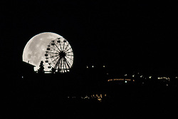 January 2, 2018 - Barcelona, Catalonia, Spain - The first supermoon of 2018 is hidden behind the ferris wheel of the Tibidabo's theme park in Barcelona, Catalonia, Spain, on January 2, 2018  (Credit Image: © Miquel Llop/NurPhoto via ZUMA Press)
