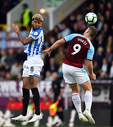 Huddersfield Town's Philip Billing and Burnley's Sam Vokes during the Premier League match at Turf Moor, Burnley