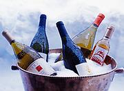 "Wine chilling in outdoor snow ""refrigerator"" along wall of Winterlake Lodge, Kirsten Dixon's kitchen, Finger Lake, Alaska."