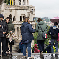 Tourists enjoy the view of the city on a rainy spring day in Budapest, Hungary on May 15, 2019. ATTILA VOLGYI