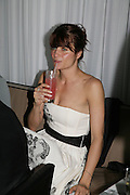 Helena Christensen playing Bingo. An Evening At Sanderson,  Sanderson Hotel, 50 Berners Street, London, W1, Charity reception now in its seventh year raising money for CLIC Sargent.15 May 2007. -DO NOT ARCHIVE-© Copyright Photograph by Dafydd Jones. 248 Clapham Rd. London SW9 0PZ. Tel 0207 820 0771. www.dafjones.com.