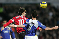 Photo: Lee Earle.<br /> Portsmouth v Manchester United. The Barclays Premiership. 11/02/2006. United's Ruud van Nistelrooy (L) heads clear from Andy O' Brien.