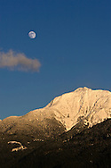 The moon rises over Mount Blanshard from Pitt Meadows, British Columbia, Canada