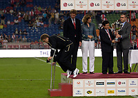 Photo: Daniel Hambury.<br />Ajax v Manchester United. Amsterdam Tournament. <br />05/08/2006.<br />Manchester's Michael Carrick on crutches at the end of the game as the sponsors prepare to present the cup.