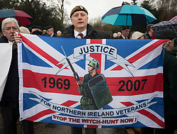 © Licensed to London News Pictures. 03/02/2018. London, UK. A former soldier holds a Union Flag banner calling justice for British Army soldiers who fought in Northern Ireland - during a Veterans for Justice March in central London .Photo credit: Peter Macdiarmid/LNP