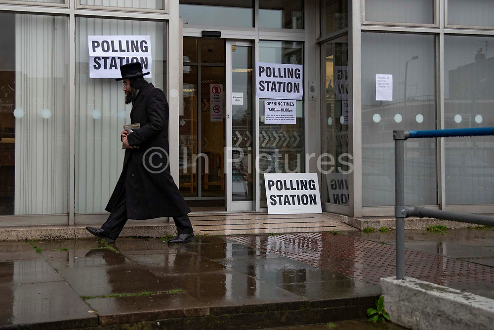An Orthodox Jewish man leaves a polling station after voting in the General Election in Stamford Hill, London, United Kingdom on 12th December 2019.