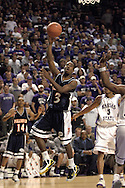 Cal State Fullerton guard Bobby Brown (3) puts up a shot from the baseline, during the first half against Kansas State at Bramlage Coliseum in Manhattan, Kansas, November 30, 2005.  K-State beat Titans of Cal State Fullerton 84-59.