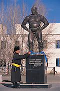 Paying homage to wrestler statue<br /> Dalanzadgad Town<br /> Gobi Desert<br /> Mongolia