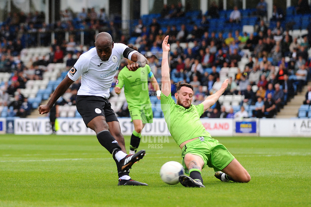 TELFORD COPYRIGHT MIKE SHERIDAN Theo Streete of Telford sees his shot blocked during the National League North fixture between AFC Telford United and Kings Lynn Town at the Bucks Head on Tuesday, August 13, 2019<br /> <br /> Picture credit: Mike Sheridan<br /> <br /> MS201920-009
