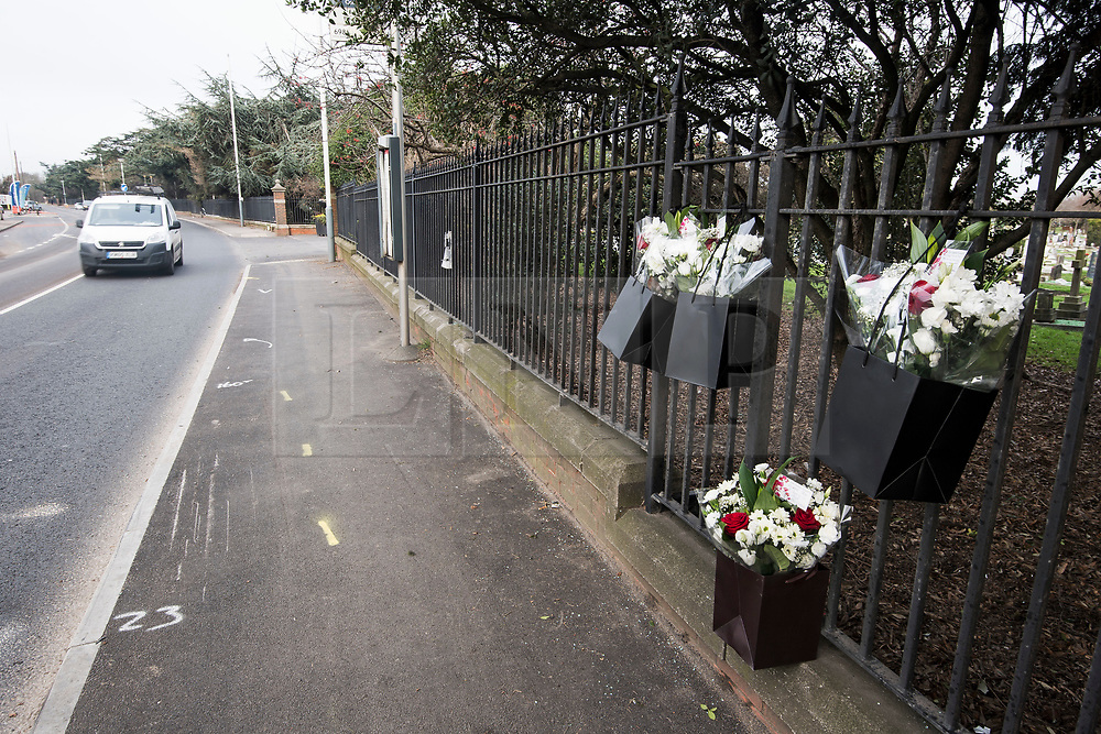 © Licensed to London News Pictures. 27/01/2018. London, UK. Flowers left by family and friends at the scene where three teenage pedestrians were killed near a bus stop in Hayes, West London after a black Audi car is believed to have collided with them. Police were called to the incident, on Friday night at 20:41hrs, close to the M4 Junction 4 following reports of a serious road traffic collision. The victims died at the scene - are all believed to be teenage males, aged approximately 16. Photo credit: Ben Cawthra/LNP