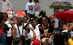 29 August 2006. New Orleans, Louisiana. Lower 9th ward. <br /> One year later and people gather at the site of the breach of the industrial canal for the Great Flood commemoration and memorial ceremony to 'honor and remember our loved ones who have passed.' People came to mark the anniversary of devastating hurricane Katrina at the site where the now repaired and allegedly in theory stronger levee flood wall. The levee breached along the industrial canal at the point where people gathered, needlessly killing hundreds of innocent civilians in the worst engineering disaster in US history.<br /> Photo Credit©; Charlie Varley/varleypix.com